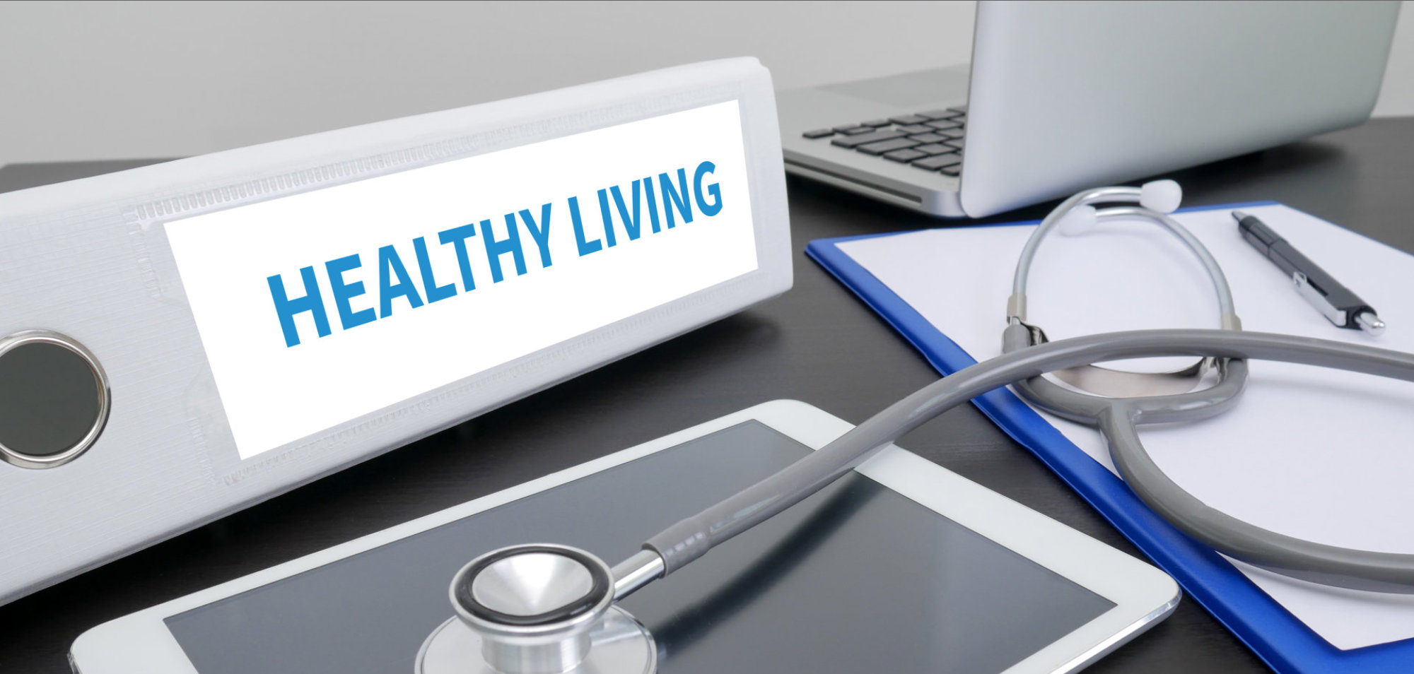 HEALTHY LIVING folder on Desktop on table. ipad
