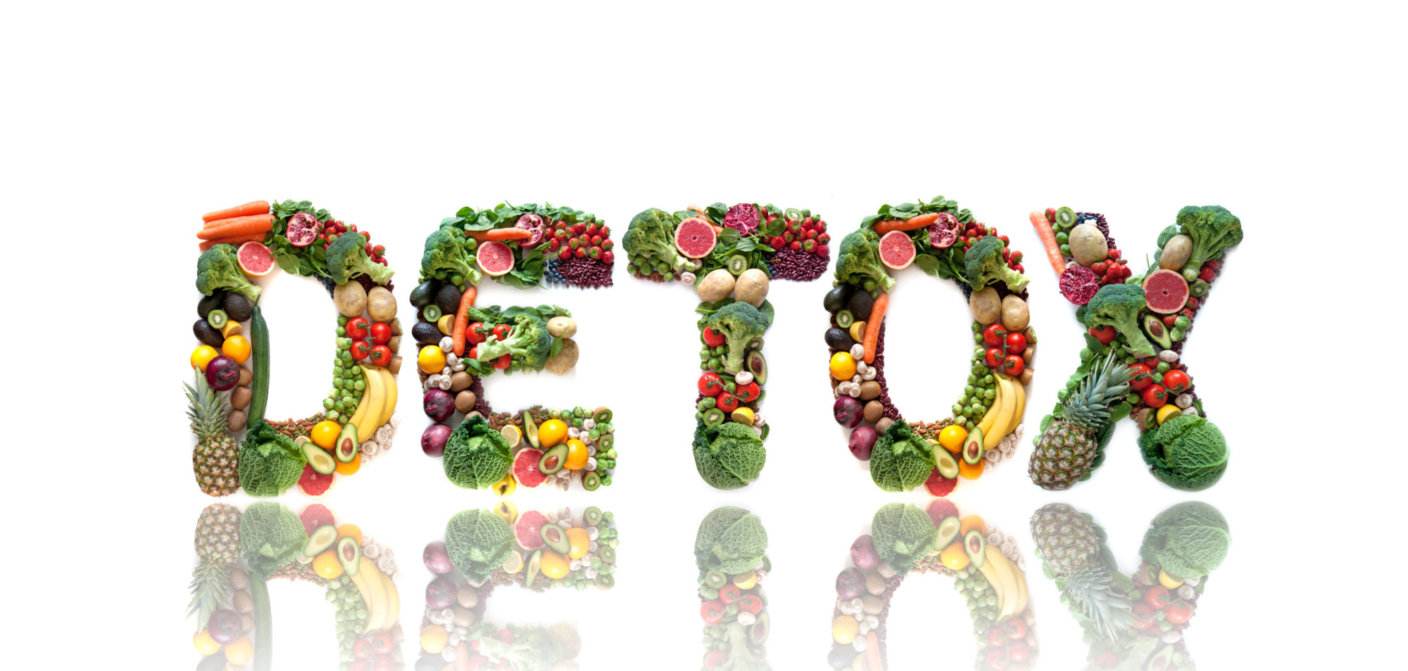 Detox spelt using large letters made of fruits and vegetables